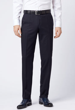 A front view of a man standing in the Hugo Boss classic fit lenon trouser in dark blue, styled with black shoes and a white shirt