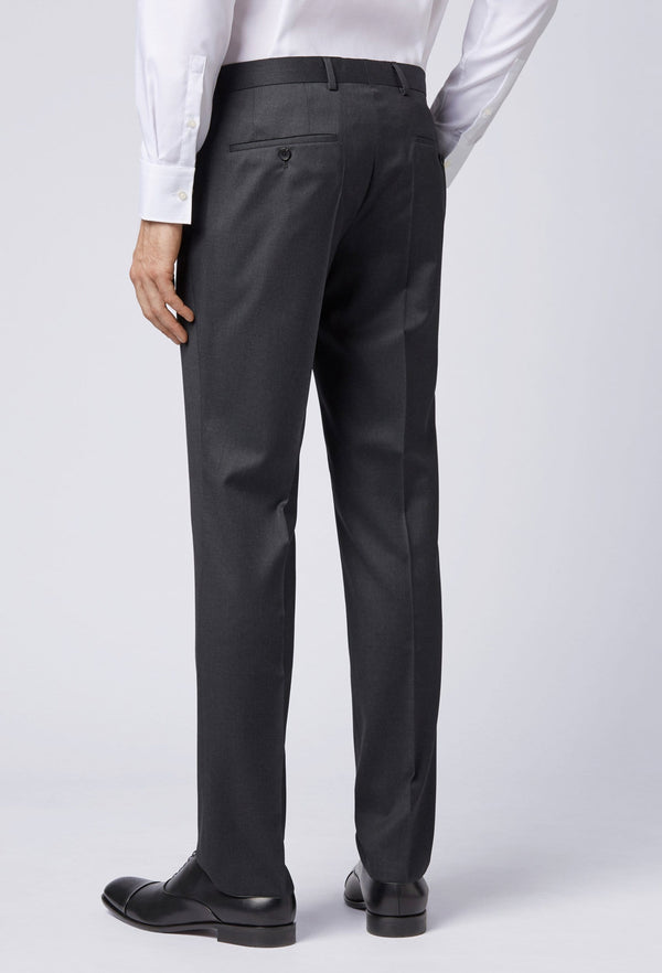 a side on view of the pocket detail on the Hugo Boss slim fit gibson trouser in dark grey pure wool HB50318499-021