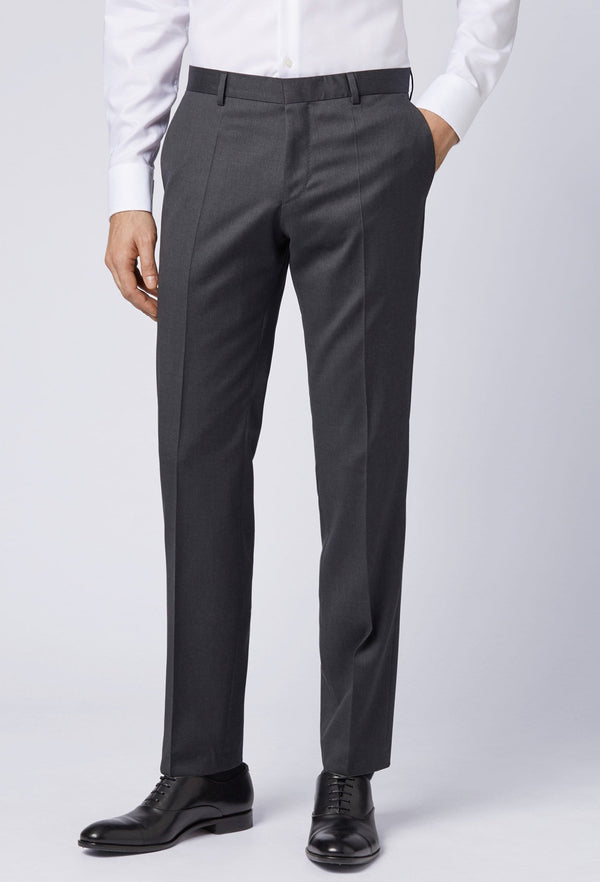 A front view of a model wearing the Hugo Boss slim fit gibson trouser in dark grey pure wool HB50318499-021