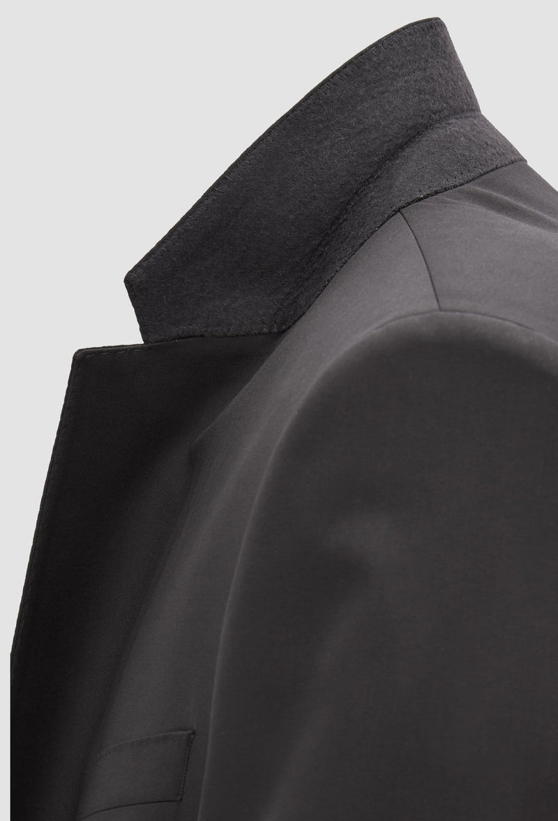 a close up of the notched lapel detail of the Hugo Boss slim fit heyes suit in black pure wool HB50318498-001