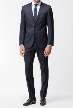 a full length view of the Hugo Boss slim fit heyes suit in dark blue pure wool HB50318498-401