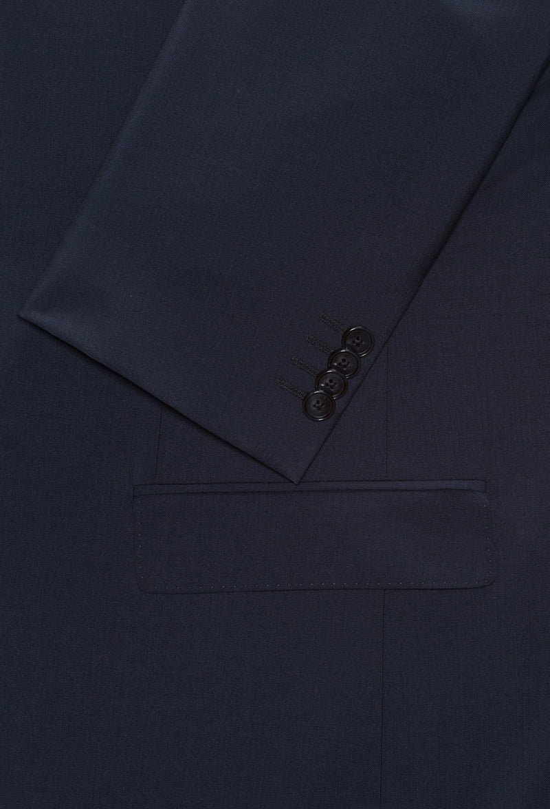 a close up view of the sleeve button and jacket pocket detail on the Hugo slim fit henry dinner suit jacket in dark blue pure wool HB50379442-401