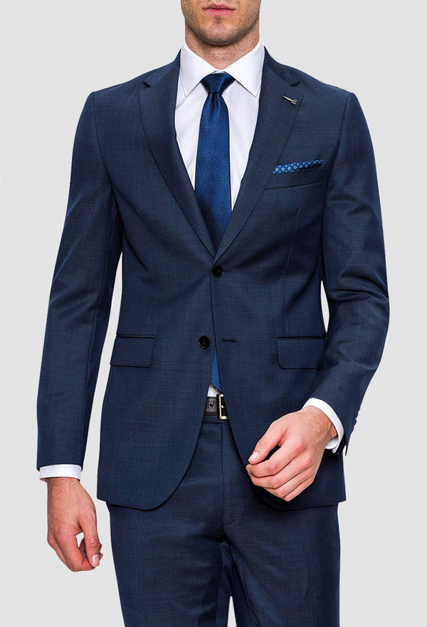 a man wears the joe black mission suit in a textured navy wool