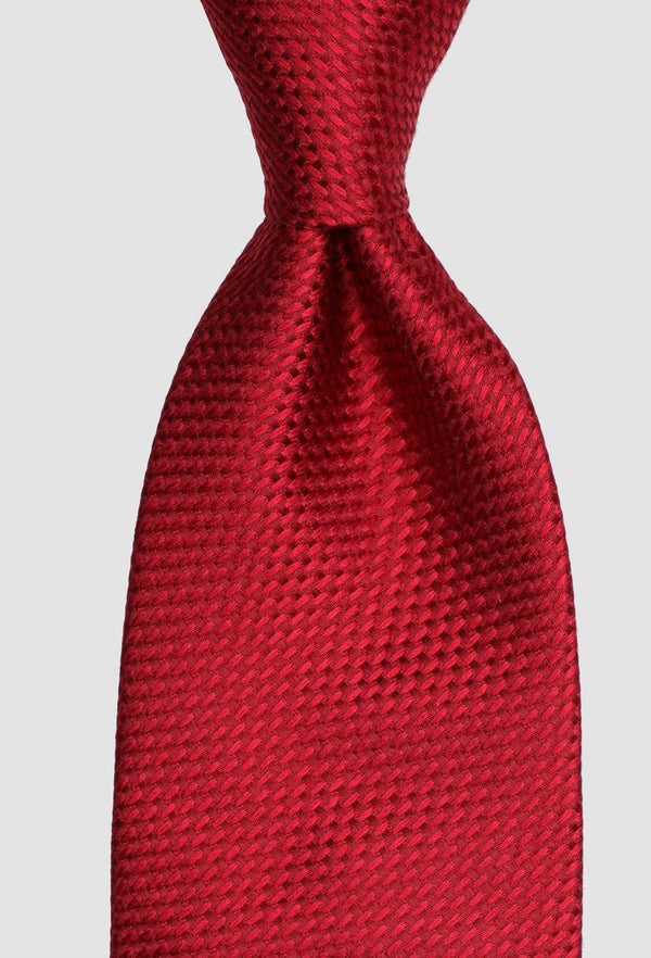 A close up of the Joe black long stitch tie in red PJAE000001 tied in a Windsor knot
