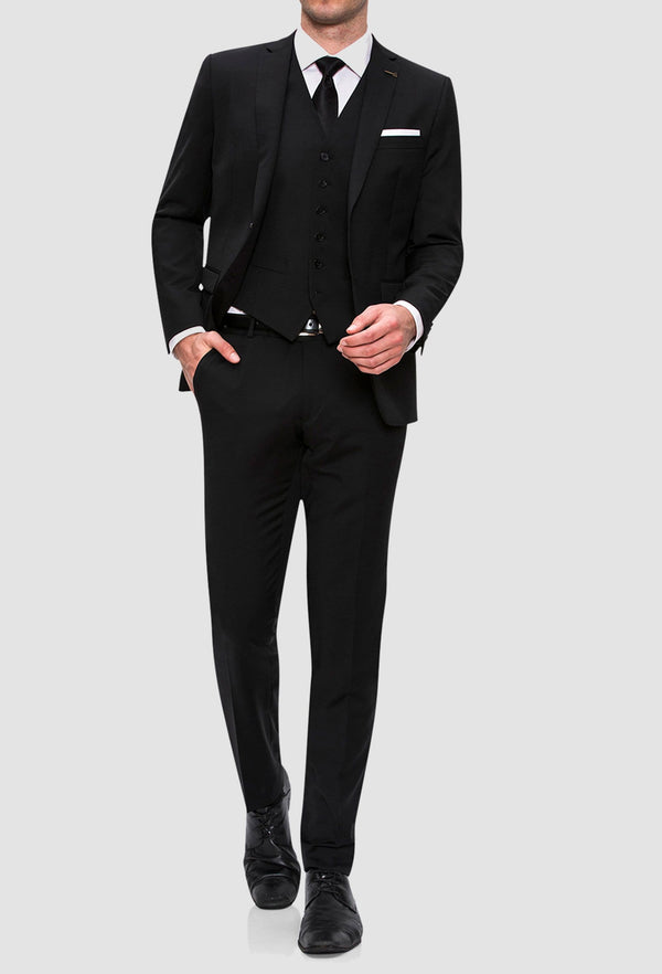 A full length view of the Joe Black slim fit anchor suit in black pure wool FJV032 styled with a white shirt