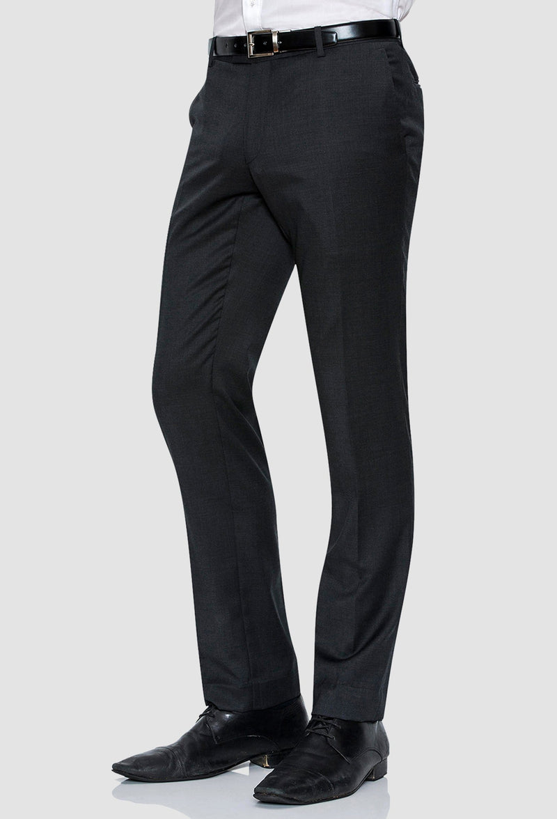 a side on view of the Joe Black slim fit razor trouser in charcoal pure wool with a white shirt and black belt