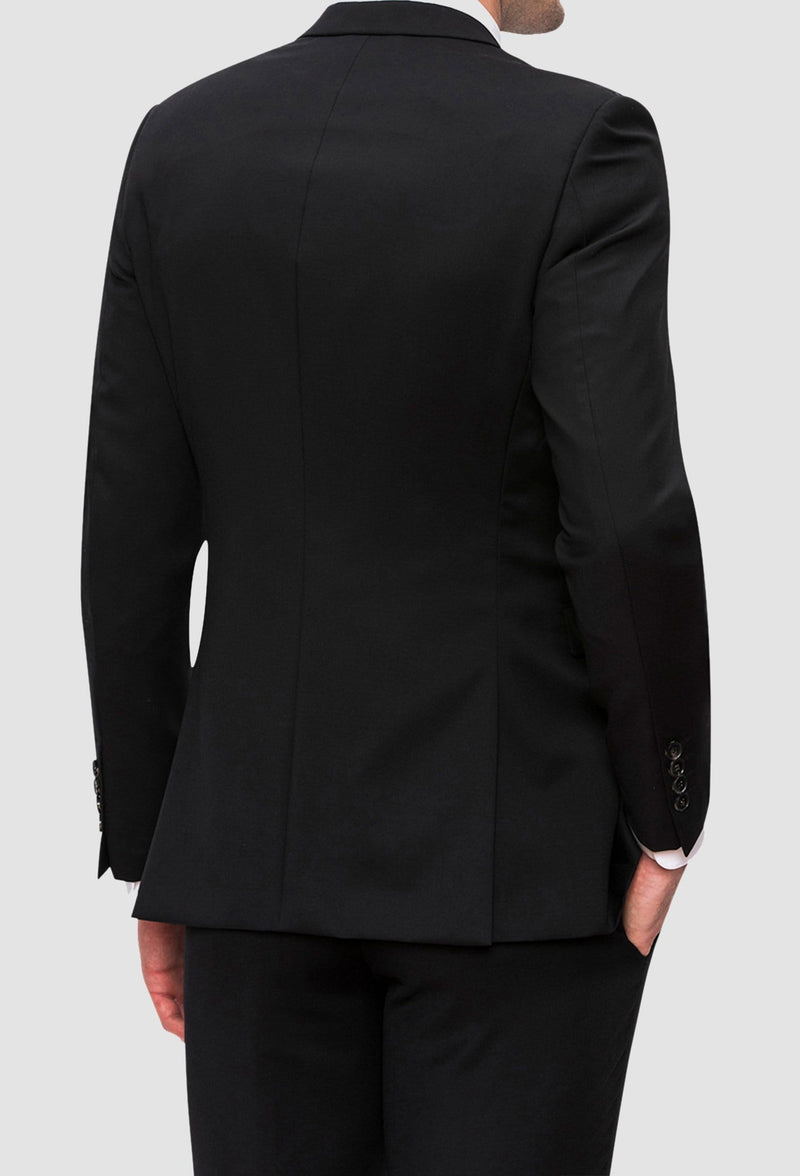 a reverse view of the Joe black anchor suit jacket in black pure wool styled with the razor trouser and a white shirt FJV032