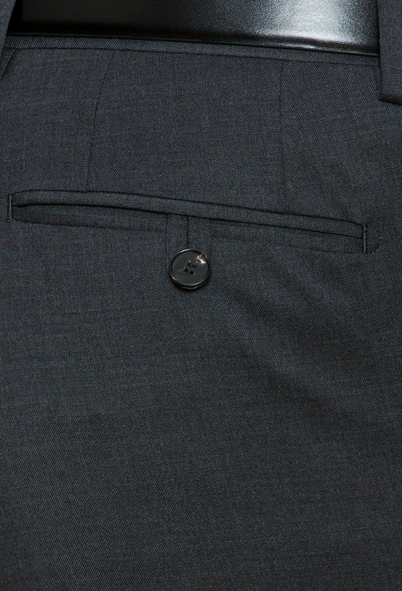 a close view of the rear hip pocket details on the Joe Black slim fit razor trouser in charcoal pure wool