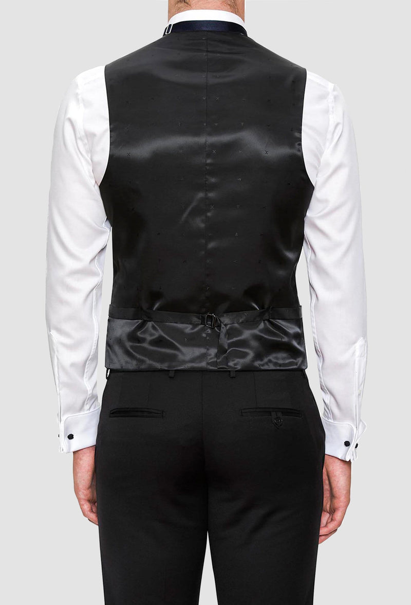 a rear view of a model wearing the Joe Black slim fit mail vest in black pure wool