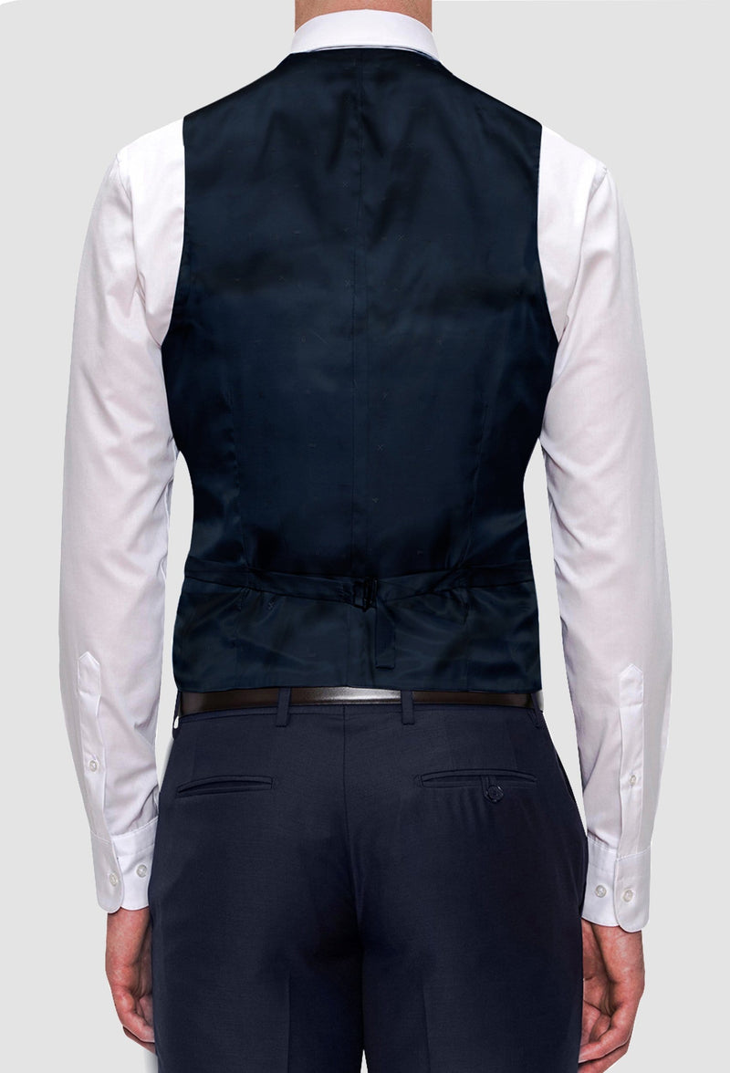a rear view of the Joe Black slim fit mail vest in navy pure wool FJV032 layered over a white shirt