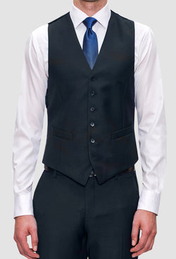 A frontal view of the Joe Black slim fit mail vest in navy pure wool FJV032 layered over a white shirt and blue tie