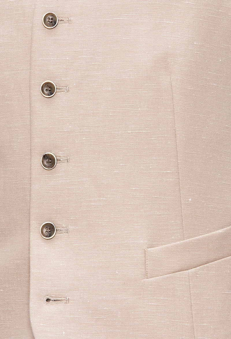 a close up view of the five button detail and angled welt pockets on the Joe Black slim fit mail vest in sand linen blend