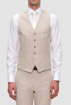 a front on view of the Joe Black slim fit mail vest in sand linen blend layered over a white shirt and white tie