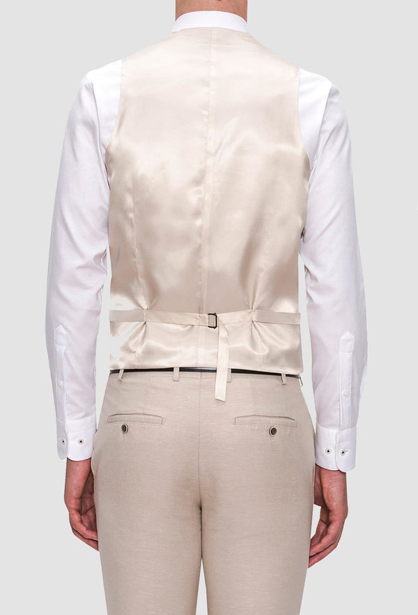 the reverse detail on the Joe Black slim fit mail vest in sand linen blend layered over a white shirt