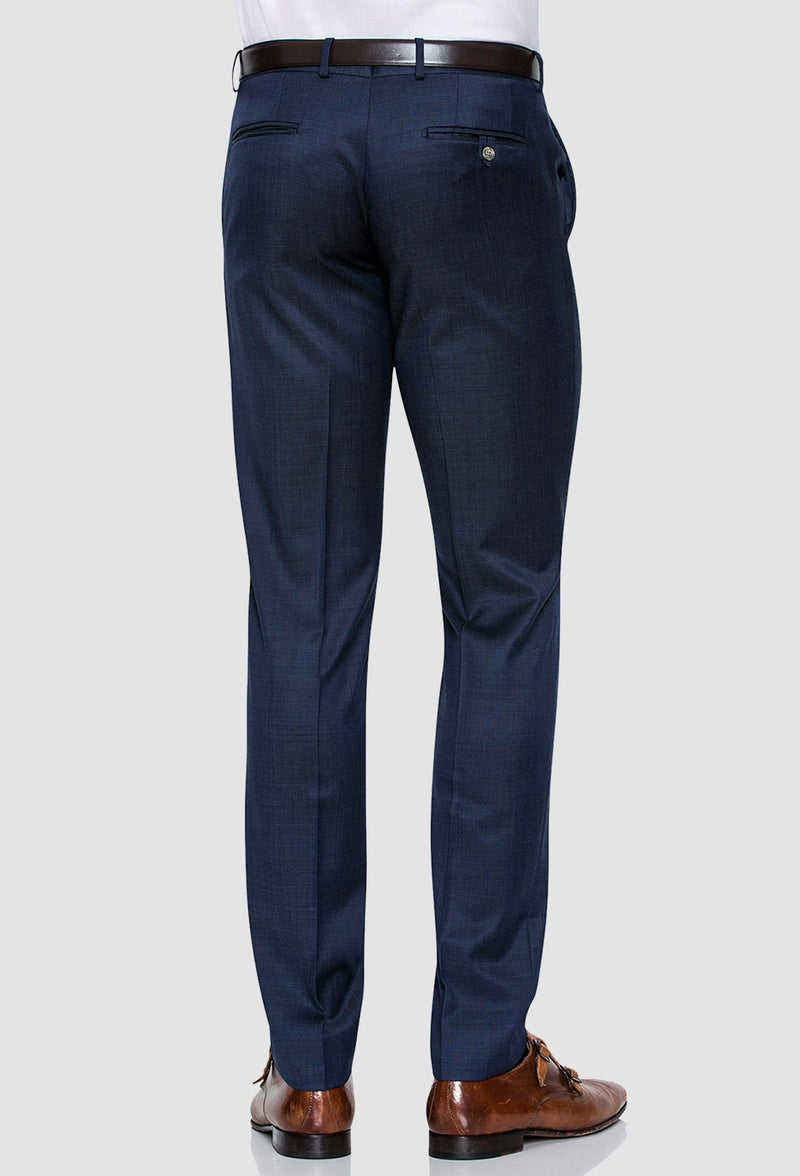 a rear view of the Joe Black slim fit razor trouser in blue pure wool worn by a model with a white shirt