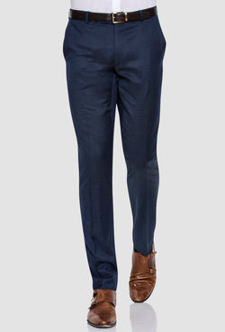 a frontal view of the Joe Black slim fit razor trouser in blue pure wool on a model walking