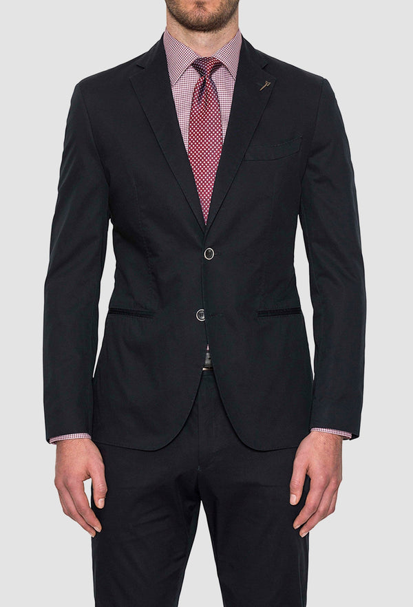 a model wears the Joe Black slim fit national sports jacket in navy styled with a pink shirt and tie