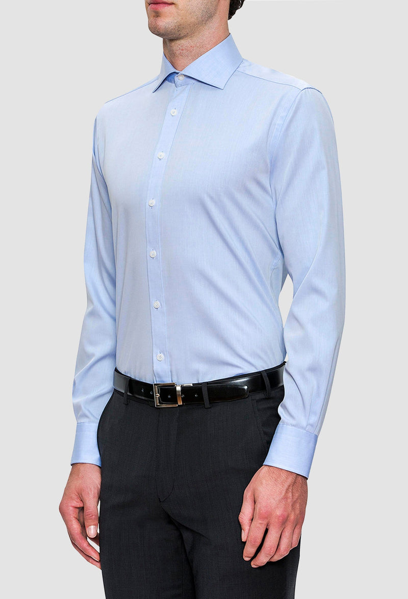 A side on view of a model wearing the Joe Black slim fit pioneer shirt in sky blue cotton FCE256