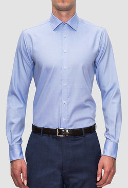 A front view of a model wearing the Joe Black slim fit pioneer shirt in sky blue cotton FCE256 with a navy trouser
