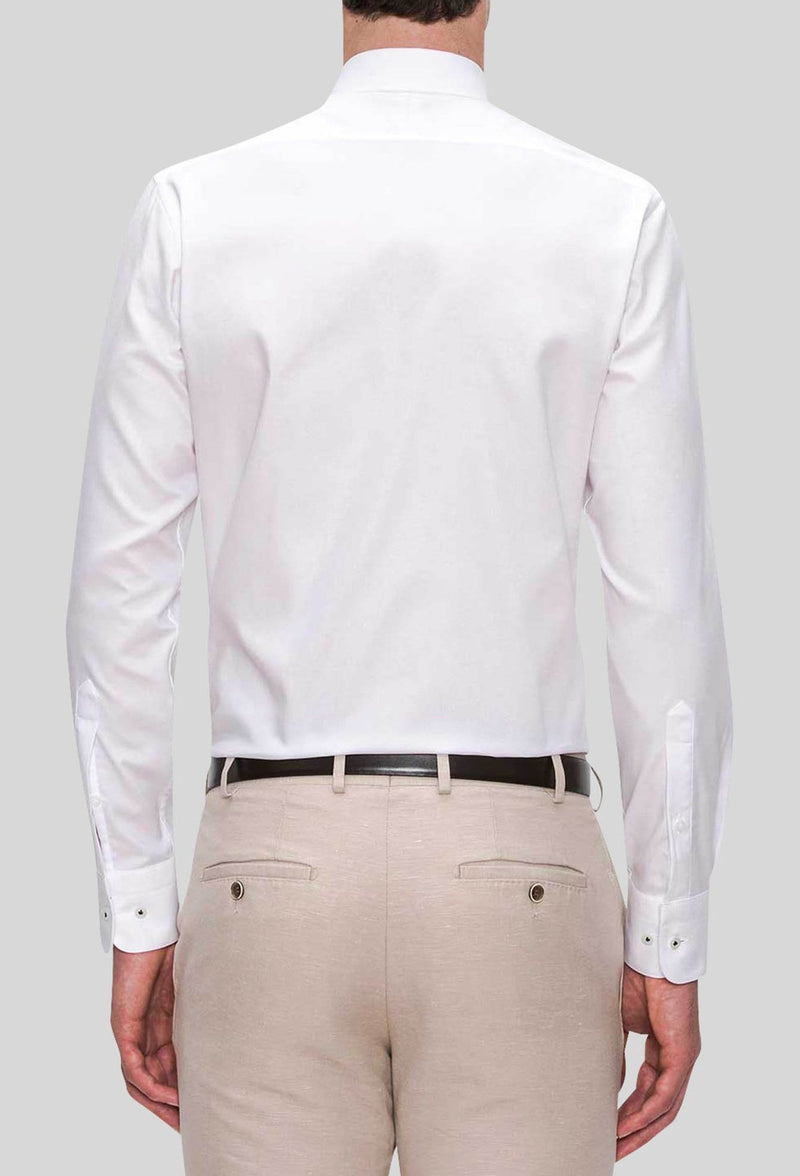 A rear view of the Joe Black slim fit pioneer shirt in white pure cotton FJD044 styled with a beige trouser