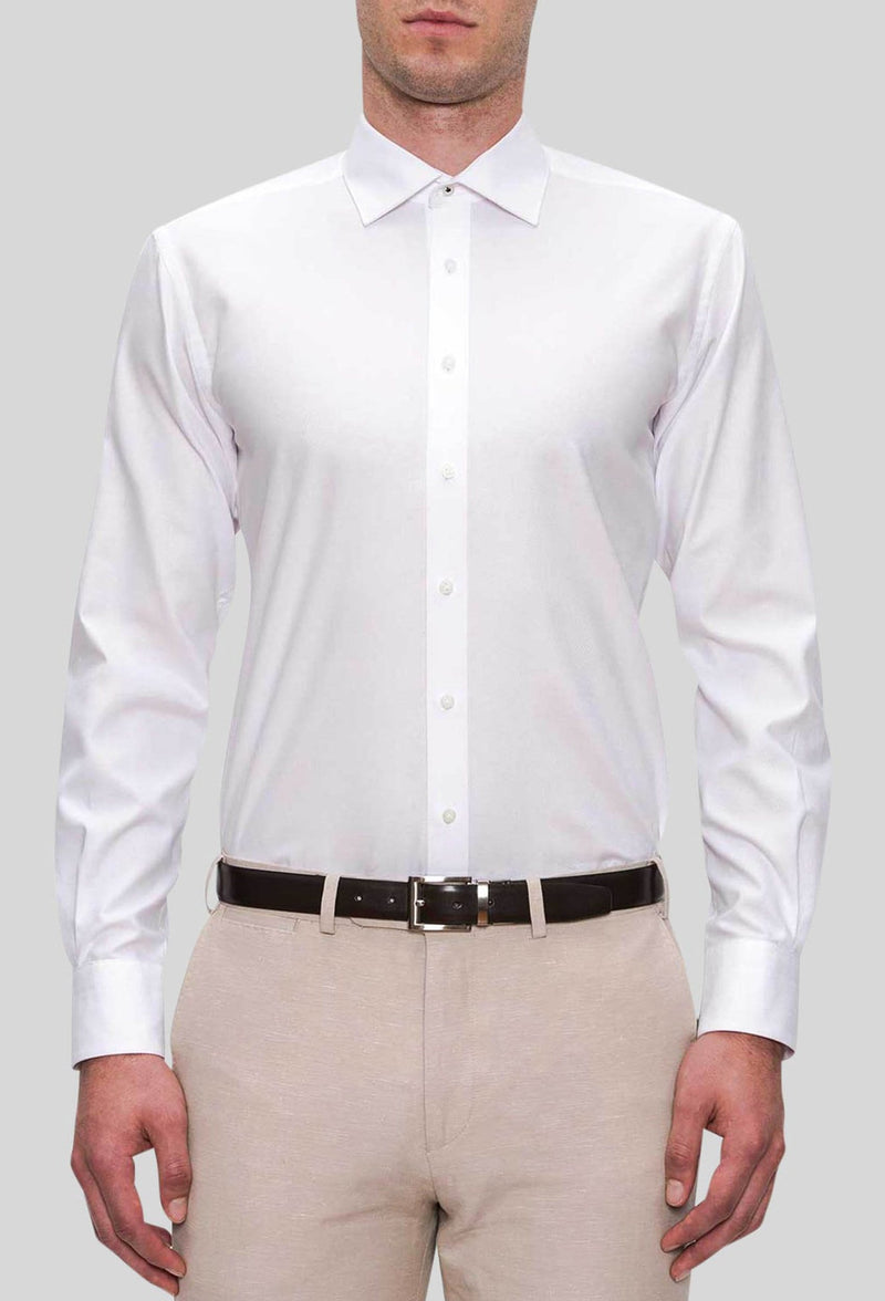 A front on view of the Joe Black slim fit pioneer shirt in white pure cotton FJD044 styled with a beige trouser