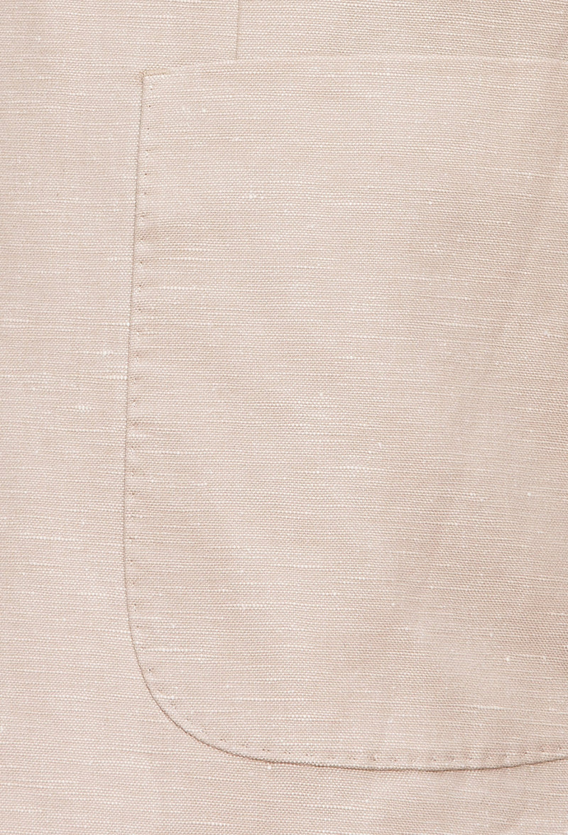 A close up view of the patch pocket detail on the Joe Black slim fit quest sports jacket in sand linen blend