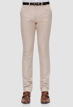 a front view of the Joe Black slim fit tourist sports trouser in sand styled with a black belt and white shirt