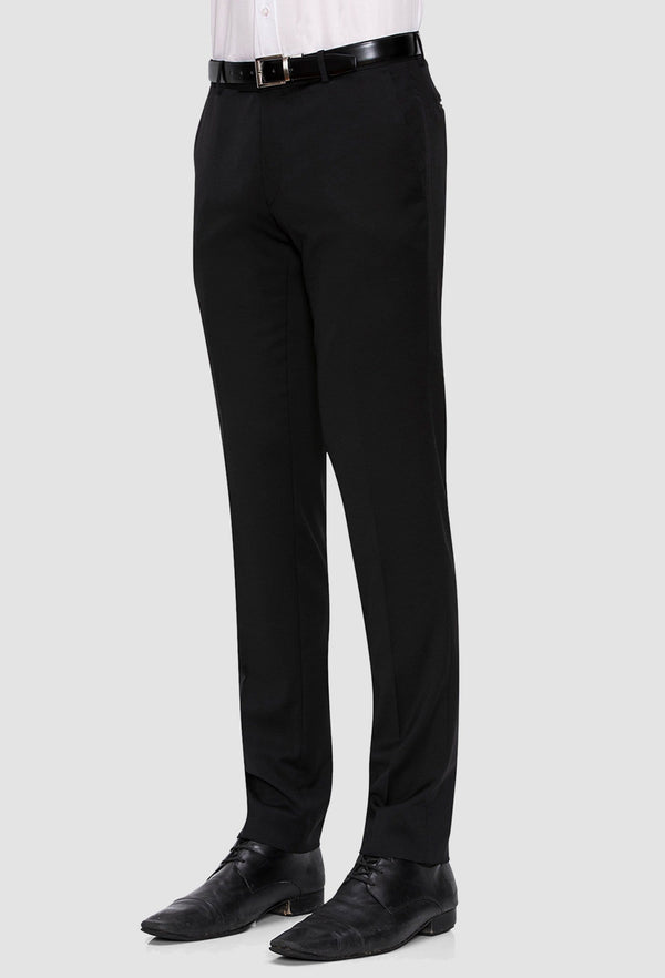 A close up view of a model wearing the Joe Black slim fit anchor suit trouser in black pure wool FJV032 against a grey background
