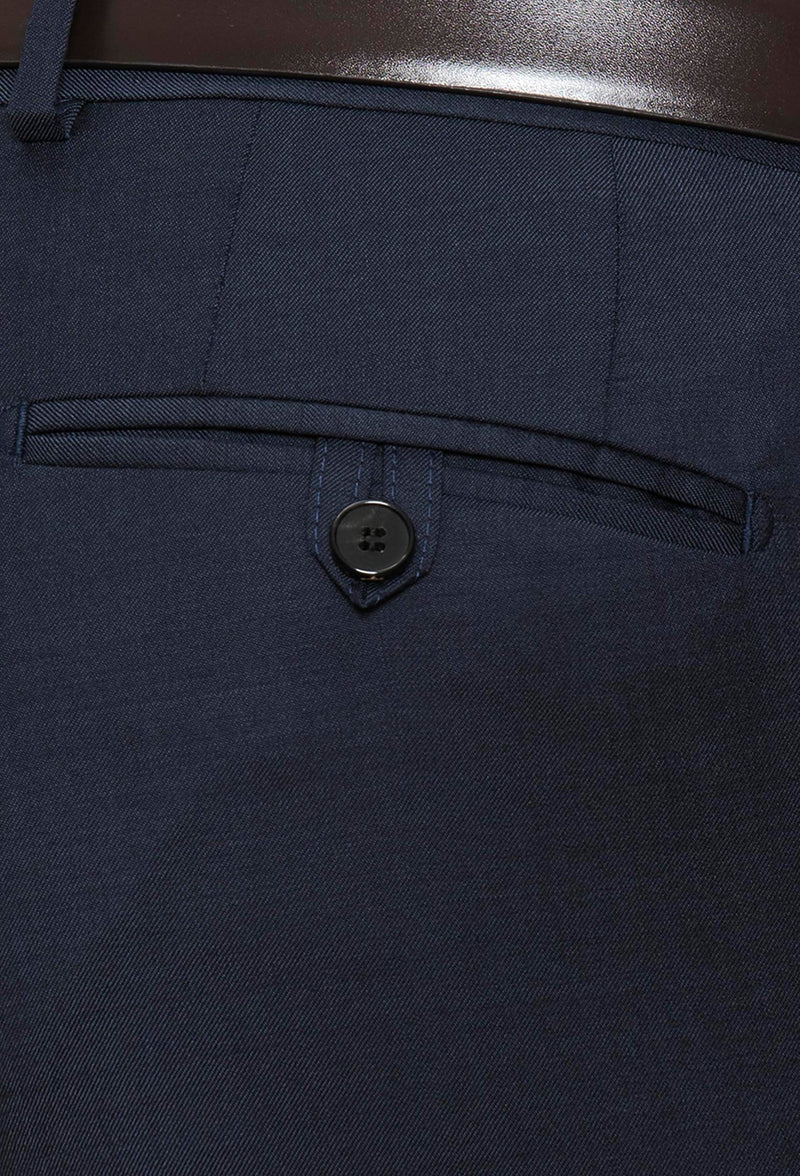 a close up view of the rear hip pocket details on the Joe Black slim fit razor trouser in navy pure wool