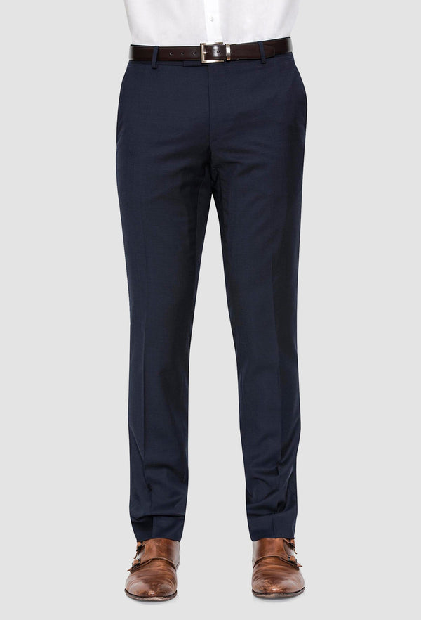 a frontal view of a model wearing the Joe Black slim fit razor trouser in navy pure wool with a white shirt