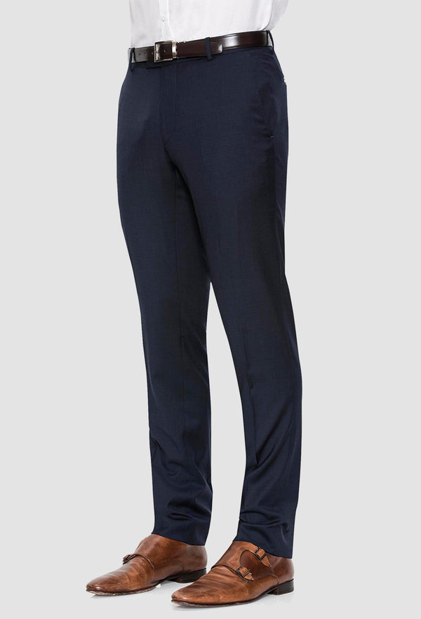 a side view of a model wearing the Joe Black slim fit razor trouser in navy pure wool