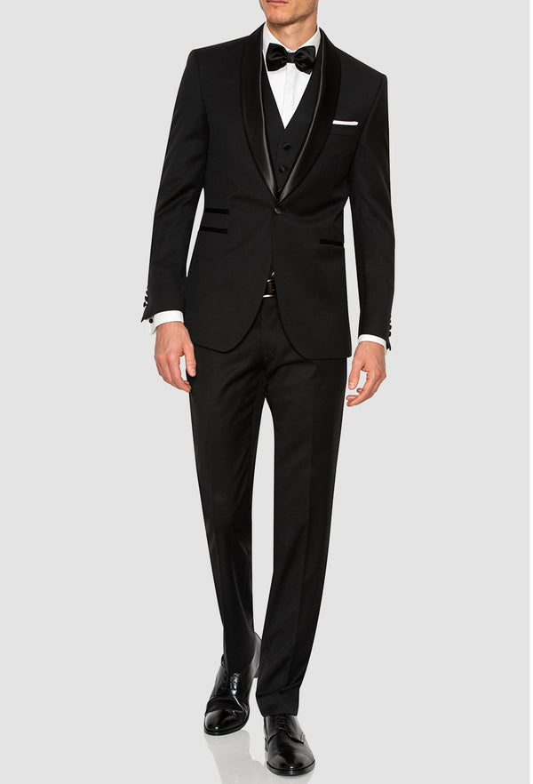 a full length view of a model wearing the Joe Black slim fit riviera evening suit in black pure wool F6447