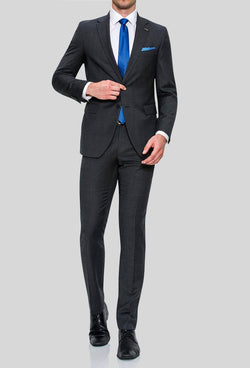 a full length view of a model wearing the Joe Black slim fit sergeant suit in charcoal pure wool FJD899