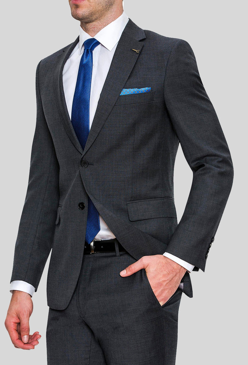a side on view of a model wearing the Joe Black slim fit sergeant suit in charcoal pure wool FJD899