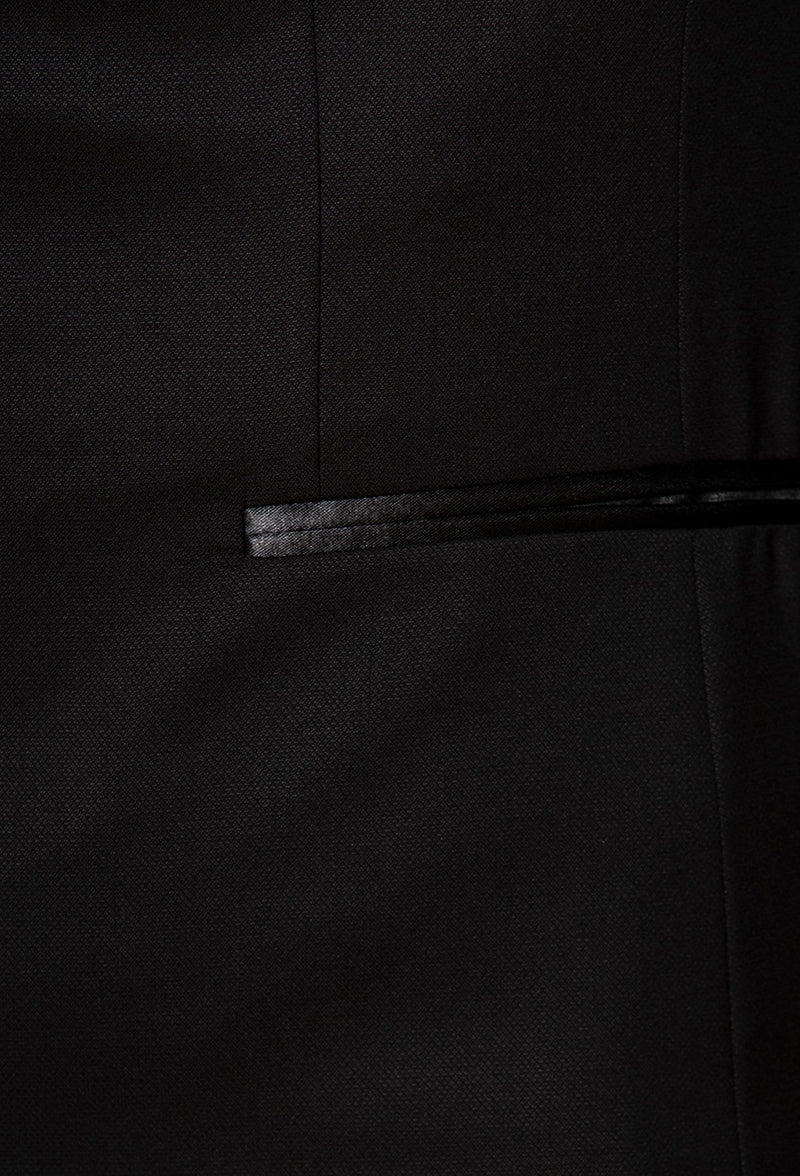 a close up picture of the satin pocket detail on the Joe Black slim fit sloane evening suit jacket in black pure wool F6447