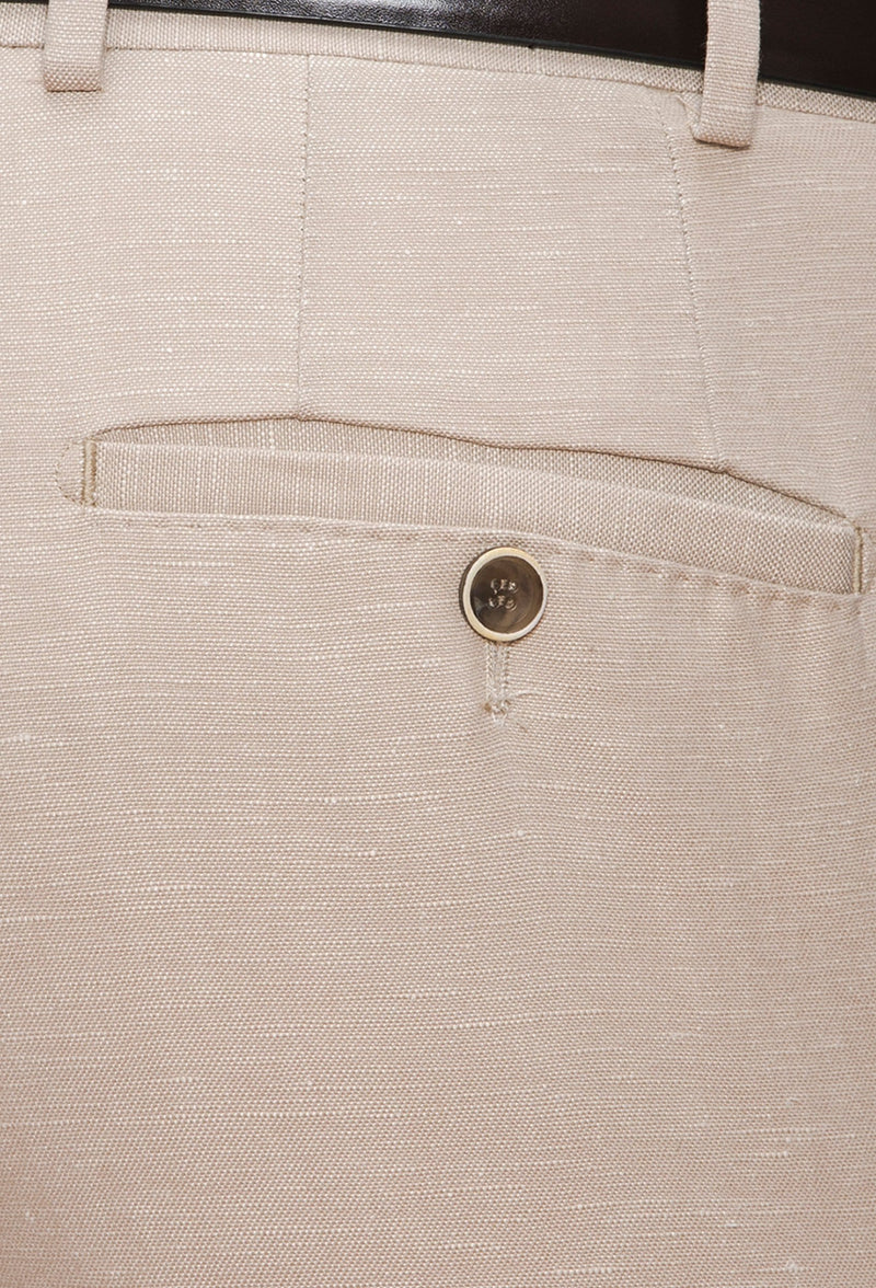 A close up view of the welt hip pockets with button closure on the Joe Black slim fit tourist sports trouser in sand linen blend