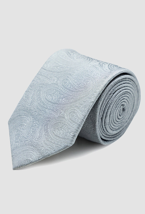 a close up view of the Joe Black paisley jacquard tie in silver PJAF000017 rolled up on a grey background
