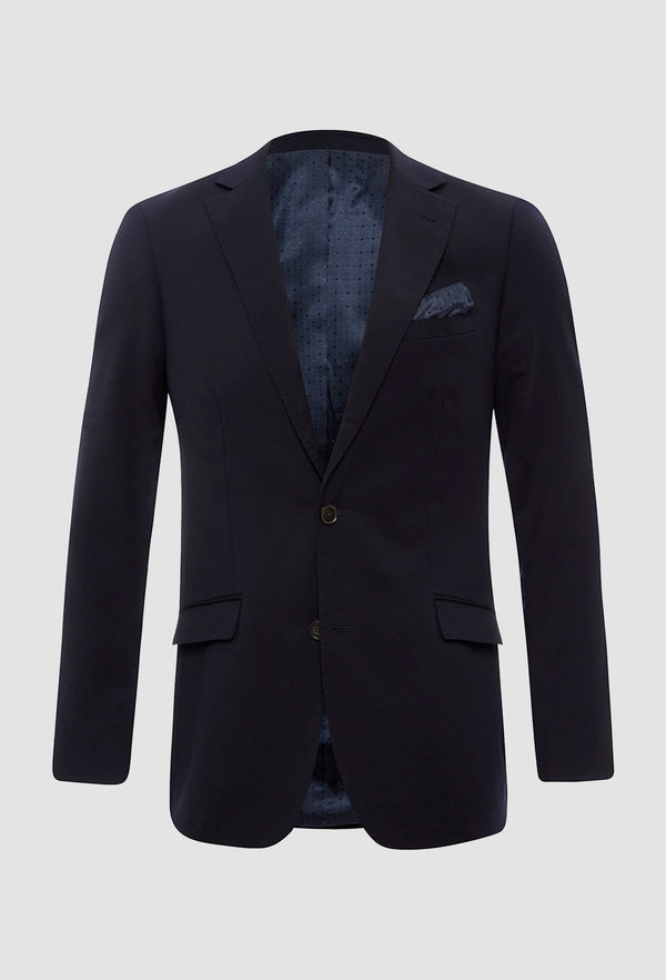 a frontal view of the Uberstone slim fit charles suit jacket in ink pure wool on a grey background