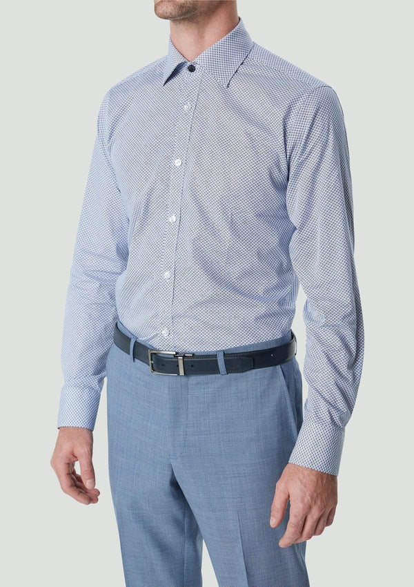 a model wears the wolf kanat slim fit romanov mens business shirt in blue geometric print 9WKS936