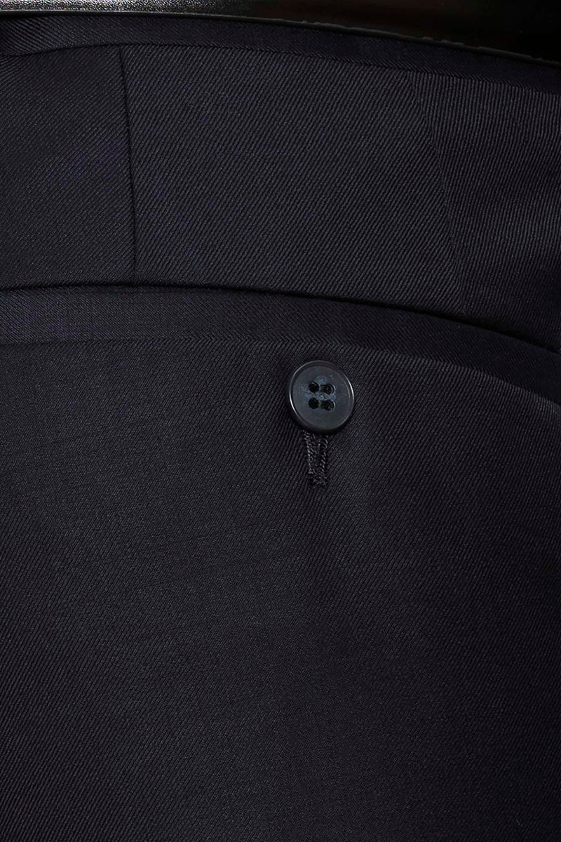 a close up view of the texxtured woven fabric of the caper suit trouser in navy pure wool