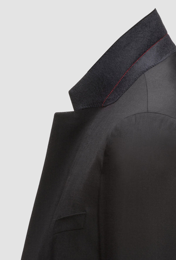 a close up view of the notched lapel detail on the Hugo slim fit henry dinner suit in black pure wool HB50379442-001