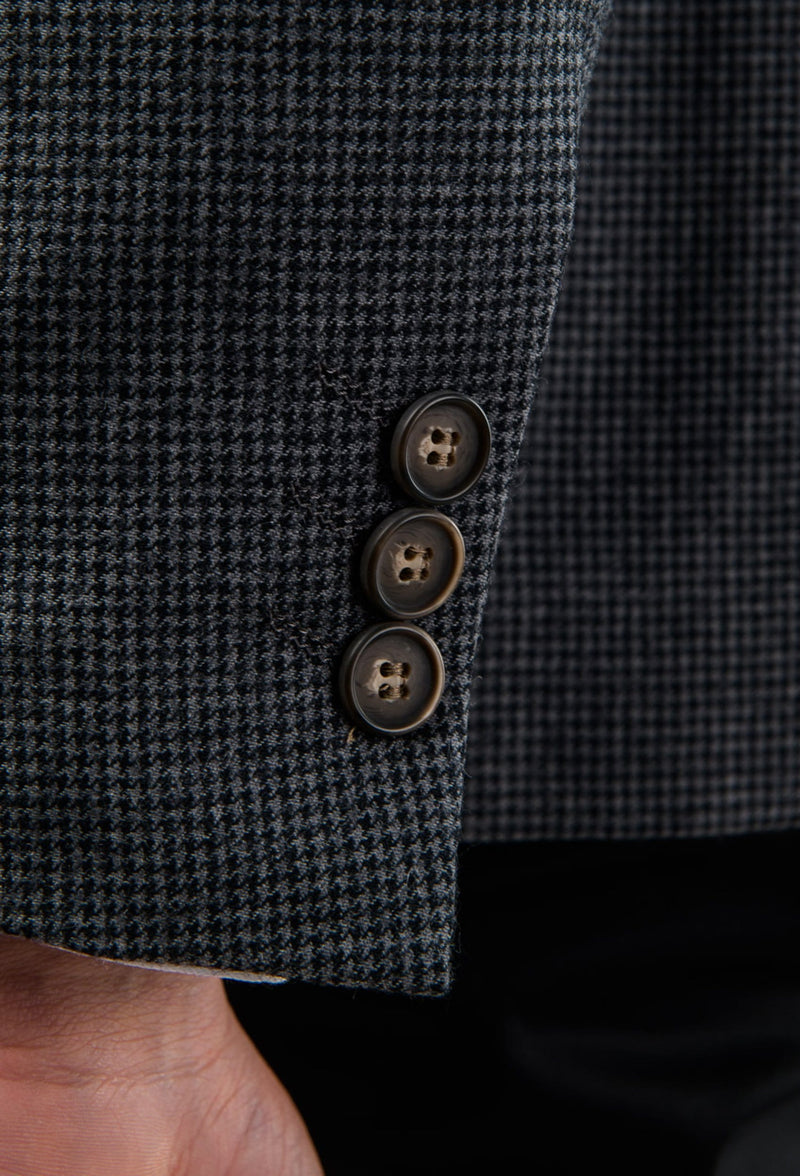 a close up view of the button detail on the Aston slim fit franklin sports jacket in charcoal pure wool A0238157SP