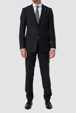 a model wears the wolf kanat slim fit hearts wool suit in charcoal with a white shirt and printed tie