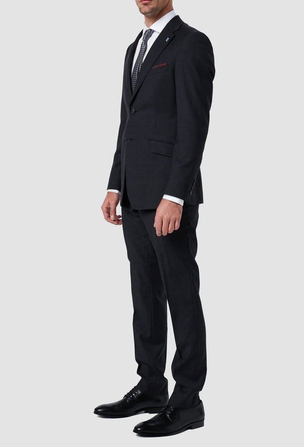 a side on view of the wolf kanat slim fit hearts wool suit in charcoal with a white shirt and printed tie