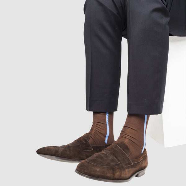 a man wearing mercerized cotton socks in brown