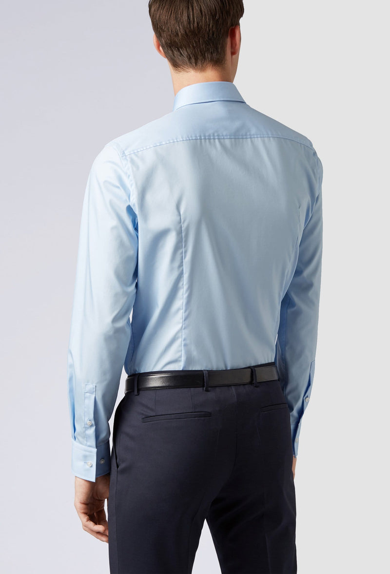 a model faces the back wearing the Hugo boss jenno business shirt in blue cotton poplin