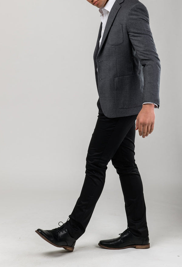 a side view of a model wearing Aston slim fit franklin sports jacket in charcoal pure wool A0238157SP