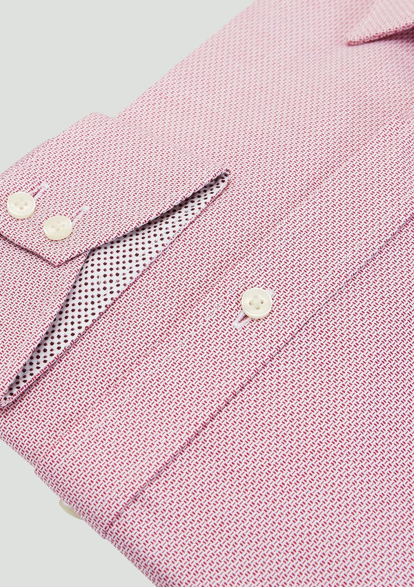 A close up view of the cuff detail on the Ted Baker slim fit endurance business shirt in pink