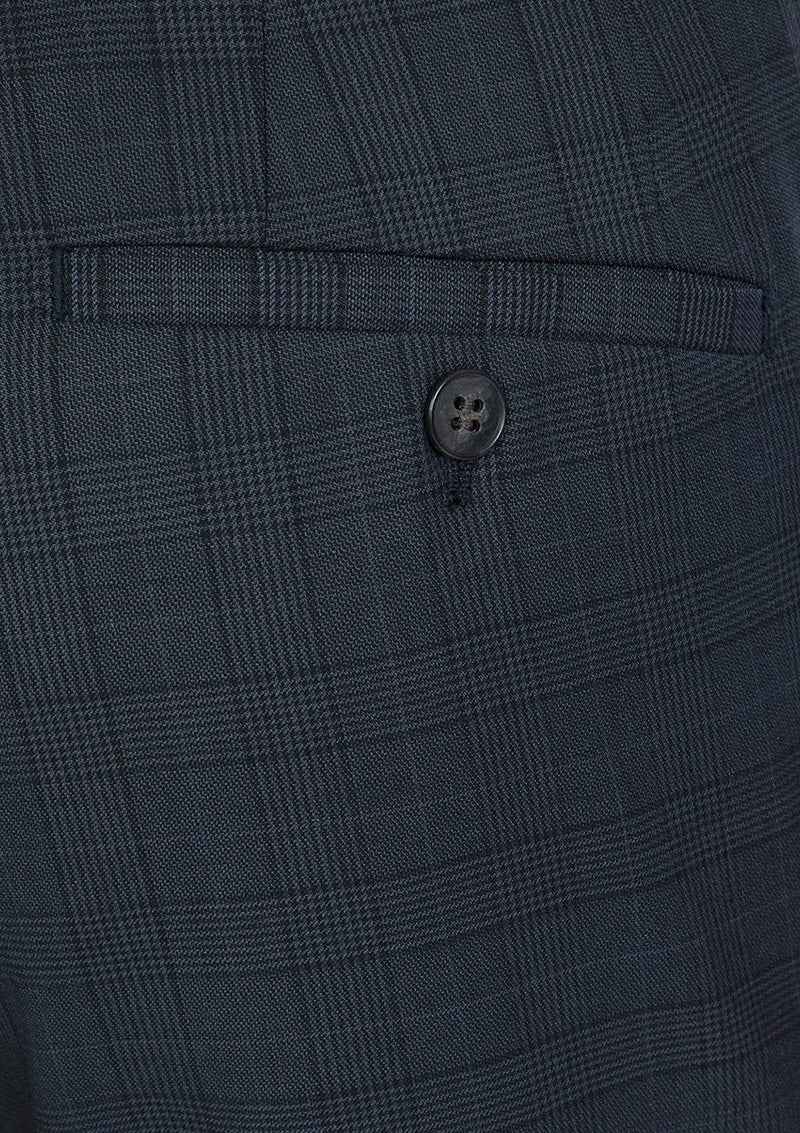 a close up fo the navy check wool fabric on the gibson slim fit caper trouser product code FG1614