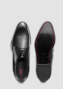 a close up of the hugo boss derby smooth leather shoes in black
